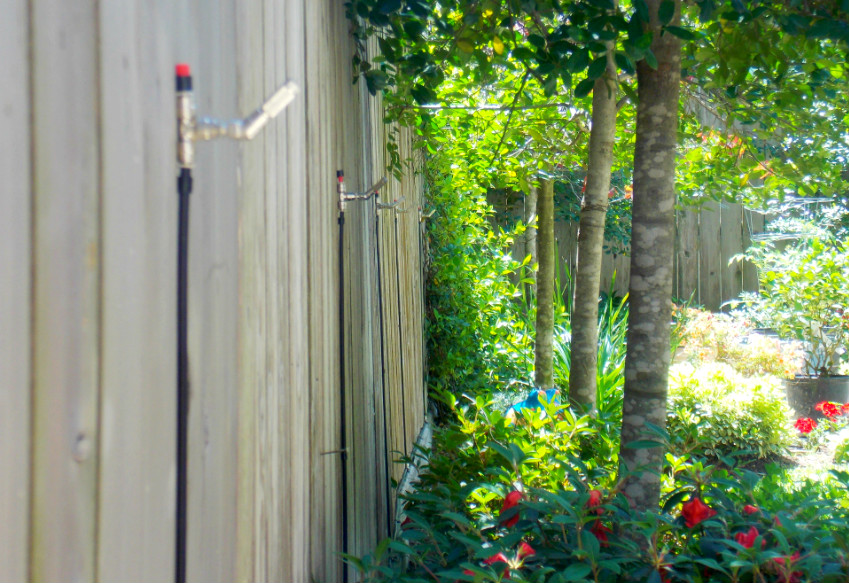 Mosquito misting system installed in backyard.